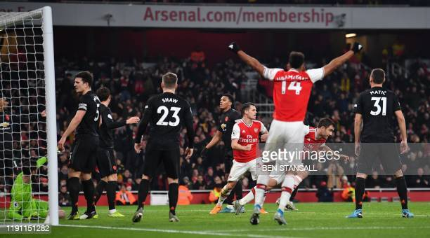 Arsenal's Greek defender Sokratis Papastathopoulos turns to celebrate after scoring their second goal during the English Premier League football...