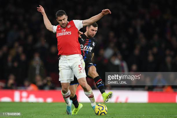 Arsenal's Greek defender Sokratis Papastathopoulos vies with Crystal Palace's Scottish midfielder James McArthur during the English Premier League...