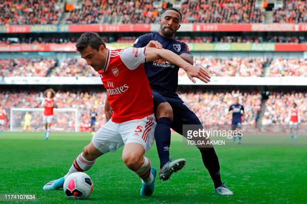 Arsenal's Greek defender Sokratis Papastathopoulos vies with Bournemouth's English striker Callum Wilson during the English Premier League football...