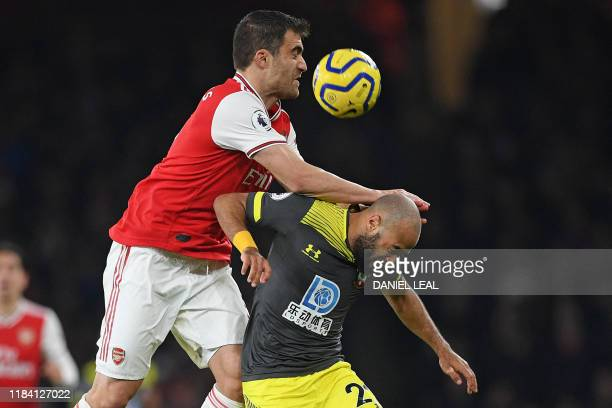 Arsenal's Greek defender Sokratis Papastathopoulos vies with Southampton's English midfielder Nathan Redmond during the English Premier League...