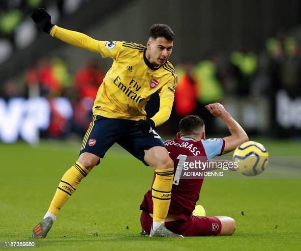 Arsenal's Greek defender Sokratis Papastathopoulos vies with West Ham United's Scottish midfielder Robert Snodgrass during the English Premier League...