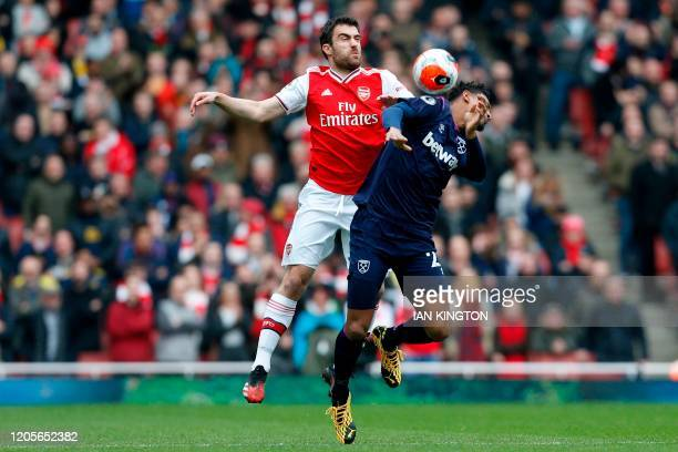 Arsenal's Greek defender Sokratis Papastathopoulos vies with West Ham United's French striker Sebastien Haller during the English Premier League...