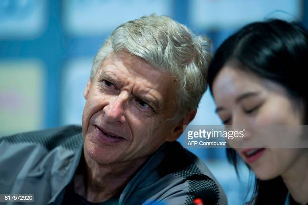 Arsenal's head coach Arsene Wenger jokes with the translator during a press conference ahead of the International Champions Cup football match...