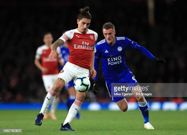 Arsenal's Hector Bellerin and Leicester City's Jamie Vardy battle for the ball during the Premier League match at the Emirates Stadium London