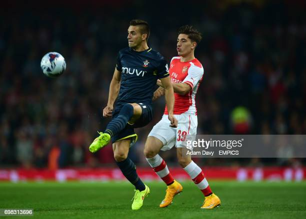 Arsenal's Hector Bellerin and Southampton's Dusan Tadic battle for the ball