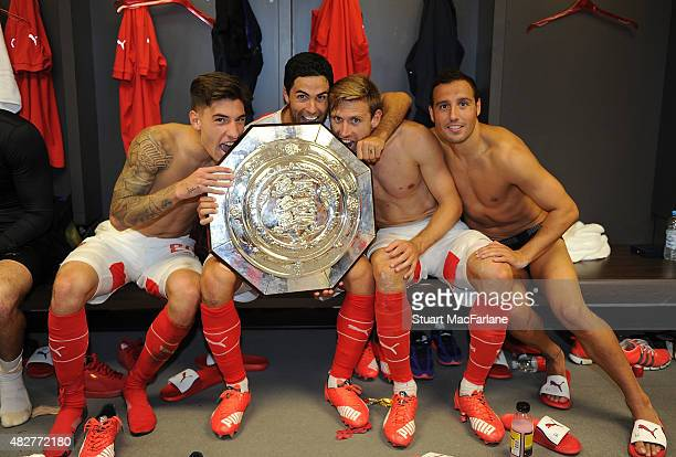 LR0 Arsenal's Hector Bellerin Mikel Arteta Nacho Monreal and Santi Cazorla celebrate after the FA Community Shield match between Chelsea and Arsenal...