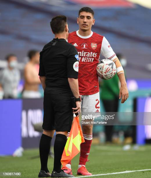 Arsenal's Hector Bellerin talks to the official during the FA Cup Final match between Arsenal and Chelsea at Wembley Stadium on August 01 2020 in...