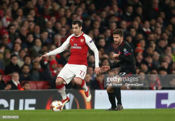 Arsenal's Henrikh Mkhitaryan and AC Milan's Fabio Borini during the Europa League Round of 16 Second Leg match between Arsenal and AC Milan at...