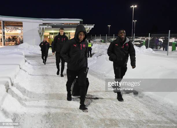 Arsenal's Henrikh Mkhitaryan and Eddie Nketiah walk from the terminal to team bus at Ostersund airport on February 14 2018 in Ostersund Sweden