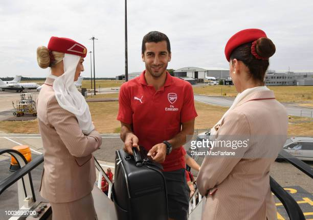 Arsenal's Henrikh Mkhitaryan boards the team flight to for the pre season tour to Singapore at Stansted Airport on July 22 2018 in Stansted England