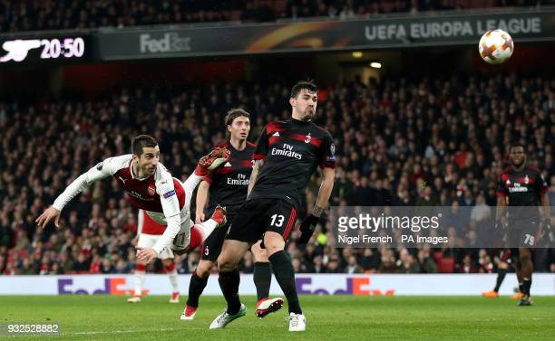 Arsenal's Henrikh Mkhitaryan heads the ball at goal during the UEFA Europa League round of 16 second leg match at the Emirates Stadium London