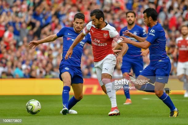 Arsenal's Henrikh Mkhitaryan skips past Chelsea's Pedro and Alvaro Morata during the Chelsea v Arsenal International Champions Cup in Aviva Stadium