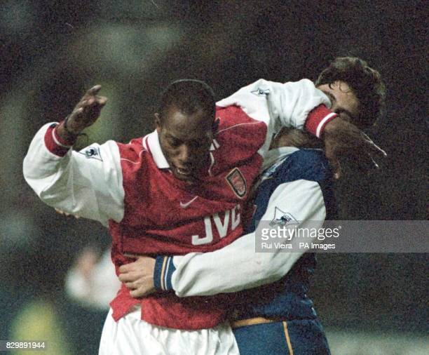 Arsenal's Ian Wright fends off the attentions of Sheffield Wednesday's Dejan Stefanovic during their FA Carling Premiership match at Hillsborough...