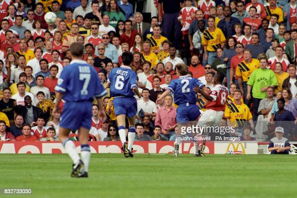 Arsenal's Ian Wright holds off Everton's Matt Jackson to score with a chip as Everton's Mark Ward and Gary Ablett look on