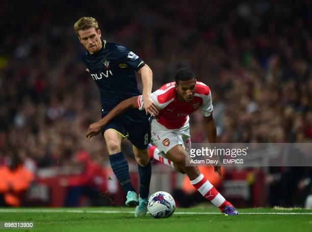 Arsenal's Isaac Hayden and Southampton's Steven Davis battle for the ball