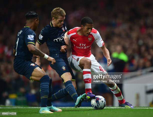 Arsenal's Isaac Hayden and Southampton's Steven Davis with Nathaniel Clyne battle for the ball