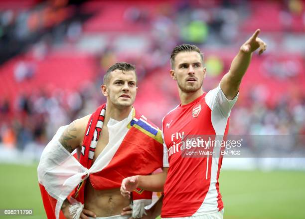 Arsenal's Jack Wilshere and Aaron Ramsey celebrate after the final whistle