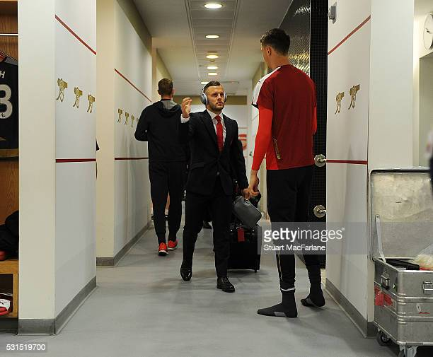 Arsenal's Jack Wilshere and Matt Macey before the Barclays Premier League match between Arsenal and Aston Villa at Emirates Stadium on May 15 2016 in...