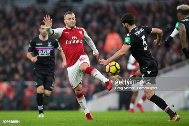 Arsenal's Jack Wilshere battles for possession with Crystal Palace's James Tomkins during the Premier League match between Arsenal and Crystal Palace...