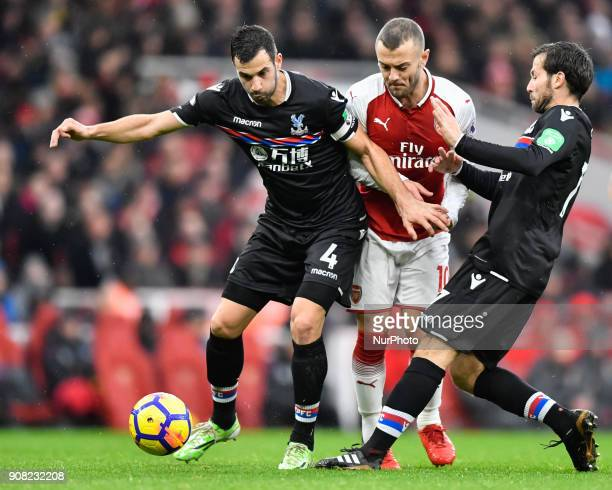 Arsenal's Jack Wilshere battles for possession with Crystal Palace's Luka Milivojevic during Premier League match between Arsenal against Crystal...