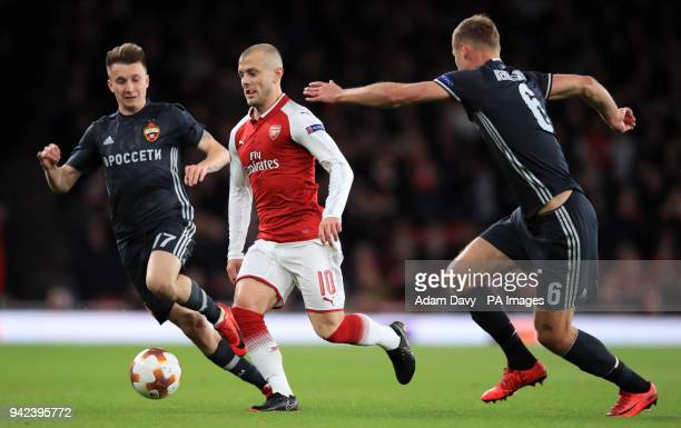 Arsenal's Jack Wilshere battles for the ball with CSKA Moscow's Alexandr Golovin and Alexsei Berezutski during the UEFA Europa League quarter final...