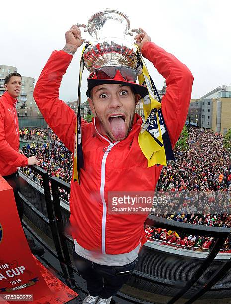 Arsenal's Jack Wilshere poses with the cup during the Arsenal FA Cup Victory Parade in Islington on May 31 2015 in London England