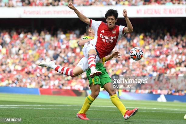Arsenal's Japanese defender Takehiro Tomiyasu takes a shot during the English Premier League football match between Arsenal and Norwich City at the...