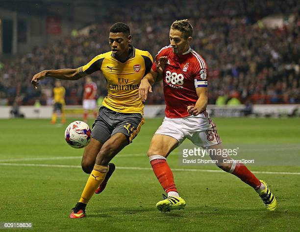 Arsenal's Jeff ReineAdelaide battles with Nottingham Forest's Chris Cohen during the EFL Cup Third round match between Nottingham Forest and Arsenal...