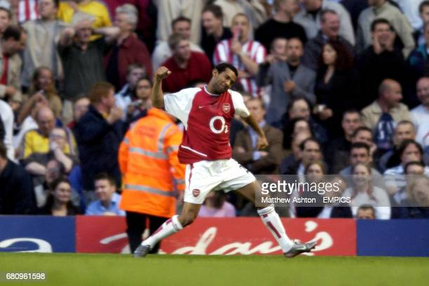 Arsenal's Jermaine Pennant celebrates in front of the dejected Southampton fans after scoring a first half hattrick