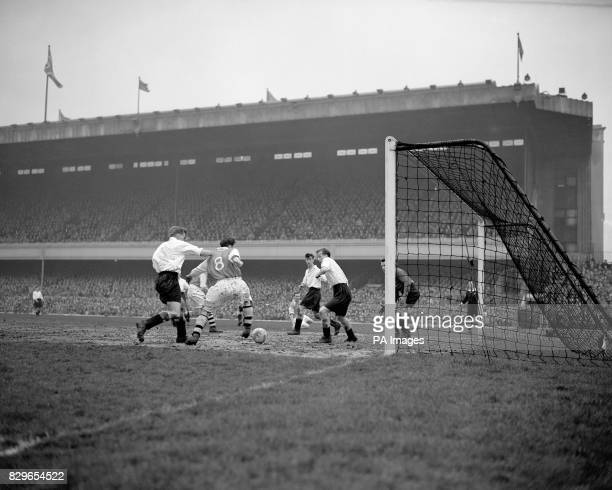 Arsenal's Jimmy Logie sneaks in at the back post to knock Arsenal's third goal past Burnley goalkeeper Des Thompson