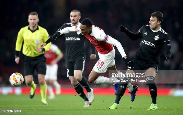 Arsenal's Joe Willock battles for the ball with Qarabag's Gara Garayev and Miguel Michel during the UEFA Europa League group E match at Emirates...