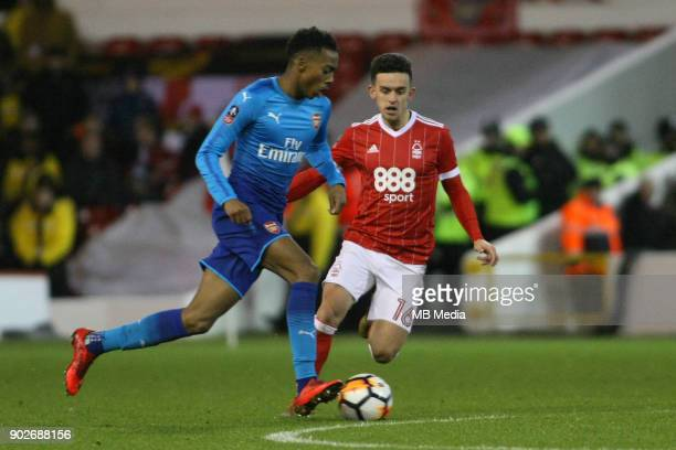 Arsenal's Joe Willock dispossesses Zach Clough of the ball during The Emirates FA Cup Third Round match between Nottingham Forest and Arsenal at City...