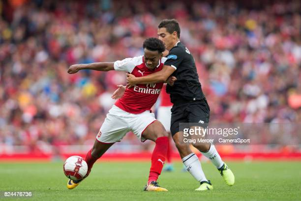 Arsenal's Joe Willock holds off the challenge from Sevilla's Wissam Ben Yedder during the Emirates Cup match between Arsenal and Sevilla FC at...
