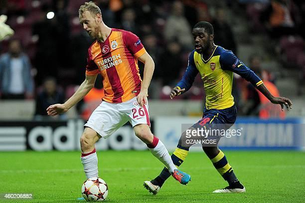 Arsenal's Joel Chambell vies for the ball with Galatasaray's Semih Kaya during the UEFA Champions League group D football match Galatasaray vs...