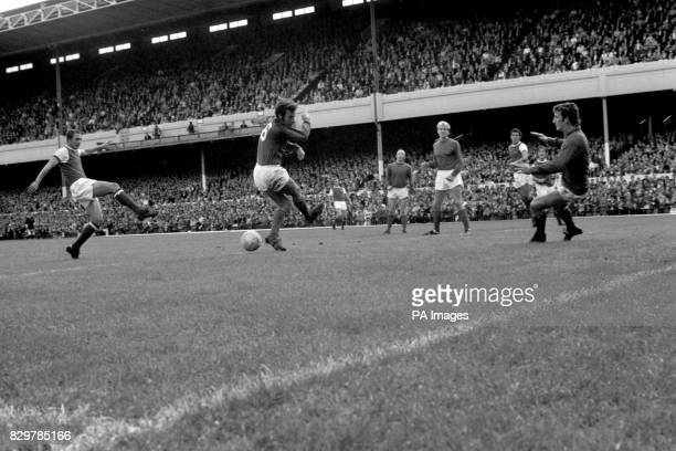 Arsenal's John Radford drives the ball past Manchester United's David Sadler and goalkeeper Alex Stepney to score his team's third goal watched by...