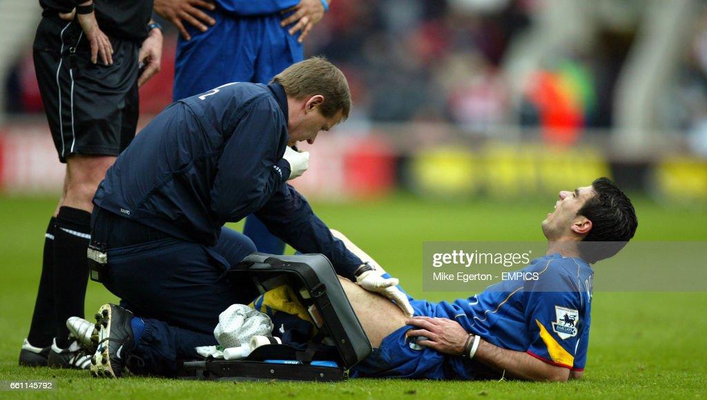 Arsenal's Jose Antonio Reyes recieves treatment for an