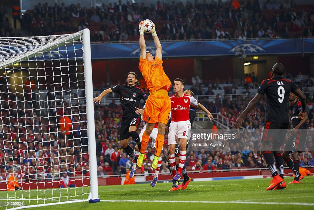 Arsenal's keeper Wojciech Szczsny saves a goal during the UEFA Champions League play-off second leg match between Arsenal and Besiktas at Emirates Stadium on August 27, 2014 in London, England.