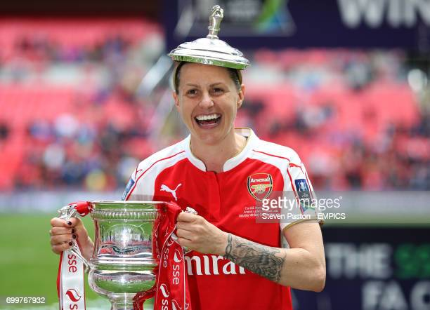 Arsenal's Kelly Smith celebrates with the SSE Women' FA Cup trophy after the final whistle