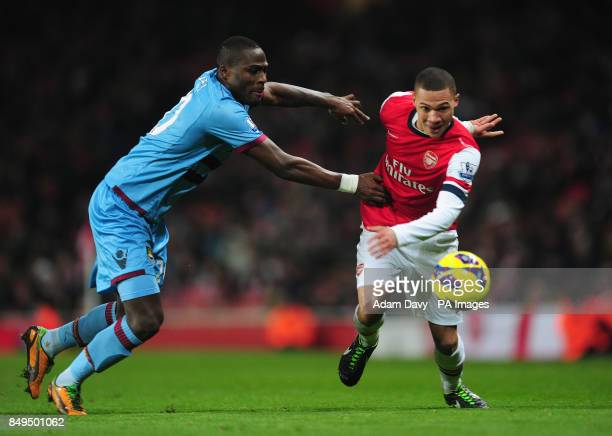 Arsenal's Kieran Gibbs and West Ham United's Guy Demel battle for the ball during the Barclays Premier League match at the Emirates Stadium London