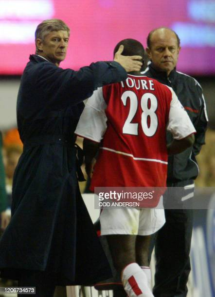 Arsenal's Kolo Abib Toure walks off the pitch after being sent off late in the first half of their Champions League match against PSV Eindhoven at...