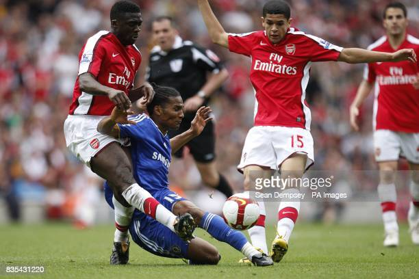 Arsenal's Kolo Toure and Chelsea's Florent Malouda battle for the ball