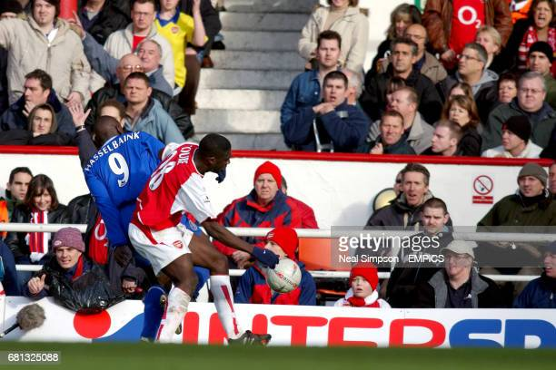 Arsenal's Kolo Toure and Chelsea's JimmyFloyd Hasselbaink battle for the ball