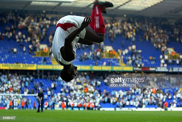 Arsenal's Kolo Toure celebrates winning the 2003/2004 Football Premier League after drawing 22 with Tottenham during their Premier League clash at...