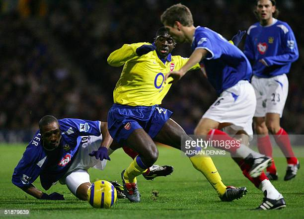 Arsenal's Kolo Toure tries to take the ball past Portsmouth's Ricardo Fuller and Gary O'Neill during the Premiership match at Fratton Park in...
