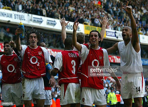 Arsenal's L to R facing camera Jose Antonio ReyesRobert PiresEdu and Thierry Henry celebrates winning the 2003/2004 Football Premier League after...