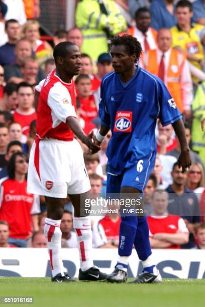 Arsenal's Lauren and Birmingham City's Aliou Cisse shake hands at the end of the game