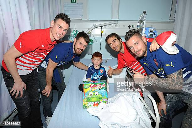 Arsenal's Laurent Koscielny Aaron Ramsey Mathieu Flamini and Mathieu Debuchy visit children at The Whittington Hospital on December 18 2014 in London...
