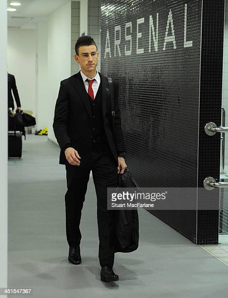 Arsenal's Laurent Koscielny arrives in the changing room before the match at Emirates Stadium on November 23 2013 in London England