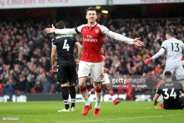 Arsenal's Laurent Koscielny celebrates scoring his side's third goal of the game during the Premier League match at the Emirates Stadium London