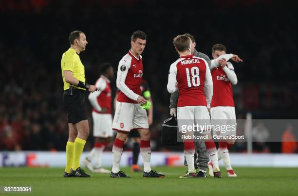 Arsenal's Laurent Koscielny is forced off with an injury during the Europa League Round of 16 Second Leg match between Arsenal and AC Milan at...